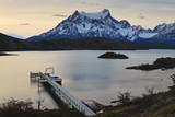 Lago Pehoe Boat and Dock with the Cordillera Del Paine at Sunset Photographic Print by Eleanor Scriven