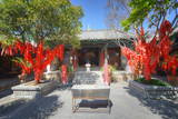 Trees with Red Ribbons at Pu Xian Temple in Lijiang Old Town, Lijiang, Yunnan, China, Asia Photographic Print by Andreas Brandl