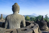 Buddha Sitting in a Stupha in the Temple Complex of Borobodur, Java, Indonesia Photographic Print by Michael Runkel