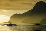 Outrigger at Sunset in the Bay of El Nido, Bacuit Archipelago, Palawan, Philippines Photographic Print by Michael Runkel