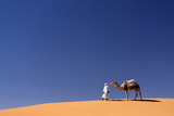 Berber Man with Camel on the Ridge of an Orange Sand Dune in the Erg Chebbi Sand Sea Photographic Print by Lee Frost