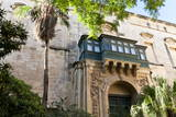 Courtyard with Maltese Balcony and Trees Photographic Print by Eleanor Scriven