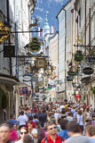 Ornate Shop Signs on Getreidegasse, Salzburgs Bustling Shopping Street, Salzburg Photographic Print by Doug Pearson