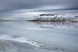 Winter View over a Frozen Lake Towards Snow-Covered Headland Near Grundarfjordur Photographic Print by Lee Frost