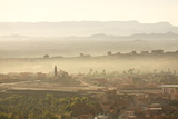 The Town of Tinerhir Soon after Sunrise, Smoke Rising from the Streets and Traditional Houses Photographic Print by Lee Frost