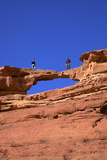 Tourists Climbing at Wadi Rum, Jordan, Middle East Photographic Print by Neil Farrin