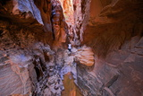 Tourist in Khazali Canyon, Wadi Rum, Jordan, Middle East Photographic Print by Neil Farrin