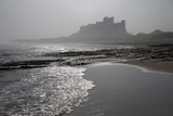Waves Breaking at Bamburgh Beach Looking Towards Bamburgh Castle on a Misty Morning Photographic Print by Ann and Steve Toon