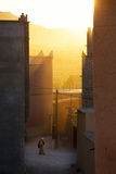 Golden Sunlight Shining Through the Streets Just before Sunset in the Town of Nkob Photographic Print by Lee Frost