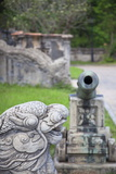 Statue and Cannon in Forbidden Purple City in Citadel, Hue, Thua Thien-Hue, Vietnam, Indochina Photographic Print by Ian Trower