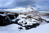 Kirkjufell (Church Mountain) Covered in Snow with a Frozen River and Waterfall in the Foreground Photographic Print by Lee Frost