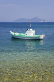 Small Boat Anchored Offshore, the Island of Atokos Visible on Horizon, Kioni Photographic Print by Ruth Tomlinson