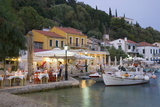 Typical Waterfront Taverna Illuminated at Dusk, Kioni, Ithaca (Ithaki) Photographic Print by Ruth Tomlinson