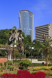 Fountain Sculpture and Jkr Tower, Kuala Lumpur, Malaysia, Southeast Asia, Asia Photographic Print by Richard Cummins