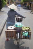 Woman Vendor Pushing Bicycle Along Street, Hoi An, Quang Nam, Vietnam, Indochina Photographic Print by Ian Trower
