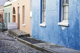 Pastel Colored Homes on Cobblestone Street in Bo-Kaap Residential District Photographic Print by Kimberly Walker