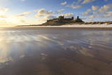 Bamburgh Castle with Snow on Bamburgh Beach, Bamburgh, Northumberland, England Photographic Print by Eleanor Scriven