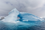 Archway Formed in a Glacial Iceberg at Cierva Cove, Antarctica, Polar Regions Photographic Print by Michael Nolan