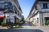 Horse Cart Riding Through the Spanish Colonial Architecture in Vigan, Northern Luzon, Philippines Photographic Print by Michael Runkel