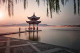 Visitors are Taking the Last Shots with a Pagoda at West Lake as the Sun Is Sinking Photographic Print by Andreas Brandl