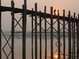 Reflection in Water and Buddhist Monk Silhouetted at Sunrise Crossing U Bein Teak Bridge Photographic Print by Stephen Studd