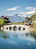 Moon Embracing Pavilion and Suocui Bridge at Black Dragon Pool in Jade Spring Park, Lijiang, Yunnan Photographic Print by Andreas Brandl