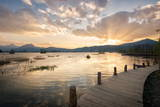 Sunset over Mountains, Lake and Boardwalk in Lijiang, Yunnan, China, Asia Photographic Print by Andreas Brandl