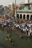 Worshippers at the Ramkund Tank on the Ghats Along the Holy River Godavari Photographic Print by Tony Waltham