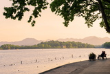 West Lake Shore with Hilly Landscape and Silhouettes, Hangzhou, Zhejiang, China, Asia Photographic Print by Andreas Brandl