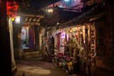 Alley at Night with Tibetan Style Hostel and Motorcycle in Lijiang Old Town, Lijiang, Yunnan Photographic Print by Andreas Brandl