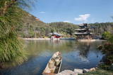 Jade Spring Park and Black Dragon Pool with Boat Carrying Wicker Baskets Photographic Print by Andreas Brandl