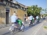 Cyclos Passing Along Street, Hoi An, Quang Nam, Vietnam, Indochina, Southeast Asia, Asia Photographic Print by Ian Trower