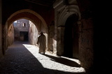 Local Man Wearing a Djellaba Casting a Long Shadow in a Sunlit Street in the Kasbah Photographic Print by Lee Frost