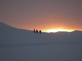 Trekking or Hiking in Winter Snow in February as the Sun Rises over the Mountains Photographic Print by Louise Murray