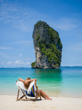 Woman Relaxing on the Beach on a Sunbed in Thailand Photographic Print by  Netfalls