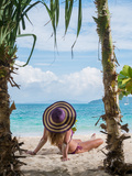 Woman Relaxing on the Beach in Thailand Photographic Print by  Netfalls