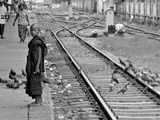 Child Monk on Rail Station in Myanmar Photographic Print by Flavie Lauvernier