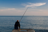 Man Pier Fishing, Lighthouse Beach, Sochi, Black Sea Coast, Krasnodar Krai, Russia Photographic Print by Green Light Collection