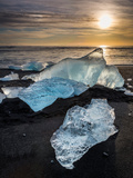 Ice on Black Sands. Ice Formations Come from the Jokulsarlon Glacial Lagoon Photographic Print by Green Light Collection