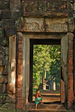 Child on Temple (Cambodia) Photographic Print by Norbert Jung