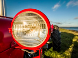 Light of Tractor, Flatey Island, Borgarfordur, Iceland Photographic Print by Green Light Collection