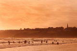 Surfers in Tramore Bay, County Waterford, Ireland Photographic Print by Green Light Collection