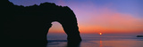 Silhouette of Natural Arch, Durdle Door, Dorset, England Photographic Print by  Panoramic Images