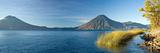 Reeds in a Lake with a Mountain Range in the Background, Lake Atitlan, Santa Cruz La Laguna Photographic Print by  Panoramic Images