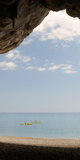 Kayak in the Sea Viewed from Cave, Cala Luna Beach, Cala Gonone, Nuoro, Sardinia, Italy Photographic Print by  Panoramic Images