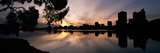 Reflection of Skyscrapers in a Lake, Lake Merritt, Oakland, California, USA Photographic Print by  Panoramic Images