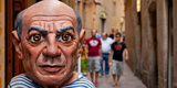 Close-Up of a Sculpture of Pablo Picasso a Spanish Painter at the Entrance of a Shop Photographic Print by  Panoramic Images