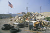 An American Flag Waving in the Distance Behind a Dump Site at the Santa Monica Community Center, CA Photographic Print