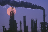 An Oil Refinery Silhouetted Against the Eerie Red of a Full Moon Photographic Print