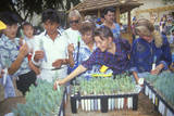 A Group of People Examining Tree Seedlings at a Booth at the 1991 Los Angeles County Fair Photographic Print